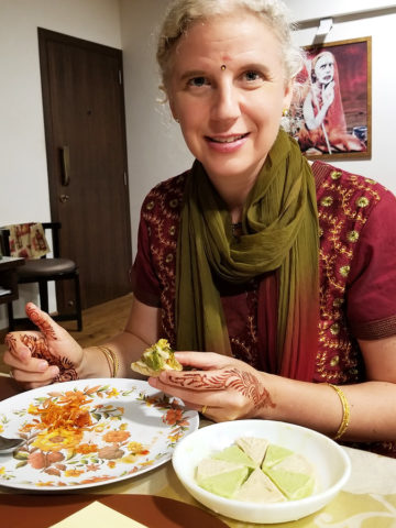 Westerner eating home-cooked Indian food in Mumbai