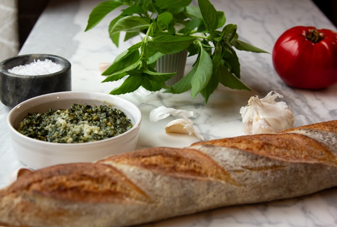 Basil pesto with a baguette, tomato, garlic and salt