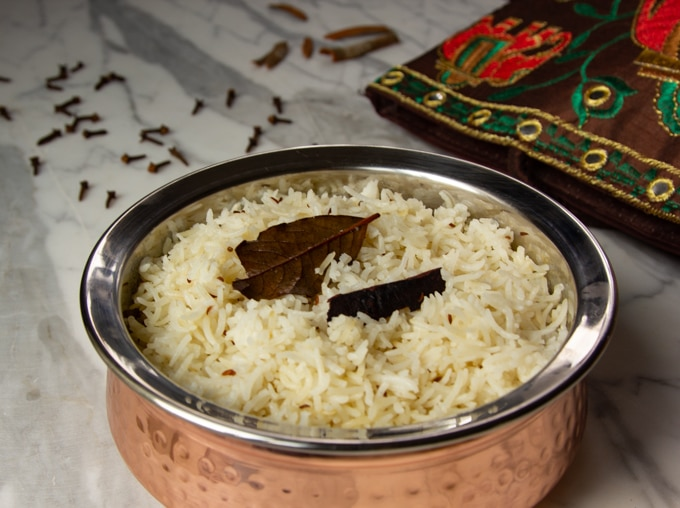 cumin rice in a serving dish