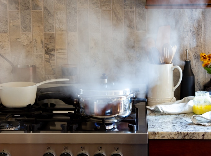 A pressure cooker releases its steam